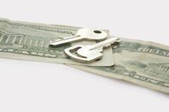 CashKeys. Two keys on dollars isolated on white background Royalty Free Stock Photo