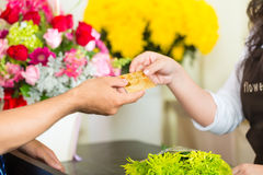 Cashless - Flower purchase with credit card. Cashless payments in a flower shop Royalty Free Stock Image