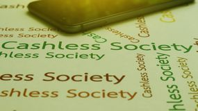 Cashless Society Concept pay with Application mobile phone. Word. Ing Cashless Society paper on background Stock Images