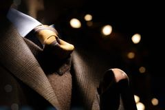 Cashmere brown jacket. With brown v-neck sweater, tie and handkerchief stock photo