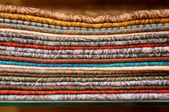 Cashmere shawls on shop shelf Stock Photos