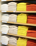 Cashmere sweaters in clothing store. Stock Photo