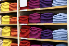 Cashmere sweaters in clothing store. Royalty Free Stock Photo