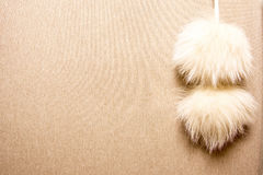 Cashmere texture with fur pompons Royalty Free Stock Photo
