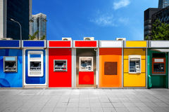 Cashpoint with colorful bankomats Stock Photography