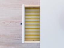 Casi abra el cajón con el fondo de las rayas del amarillo fotos de archivo libres de regalías