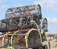 Casiers de pêche au bord du quai Image libre de droits