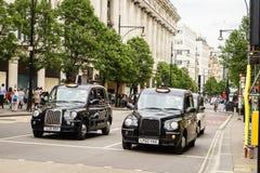 Casilla de taxi negra en Londres Fotografía de archivo