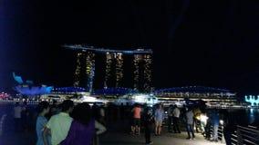 Casinò di Singapur di notte dell'orizzonte Fotografia Stock