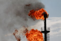 Casing-head gas. Torches for casing-head gas flaring during oil Royalty Free Stock Photos