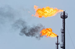 Casing-head gas. Torches for casing-head gas flaring during oil Royalty Free Stock Photography