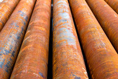 Casing pipes. Corroded steel casing pipes situated near an oil well Royalty Free Stock Photos
