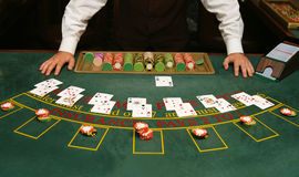Casino. Table with cards ready for playing stock photography