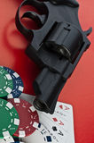 Casino. Revolver, cards and counters stock photography
