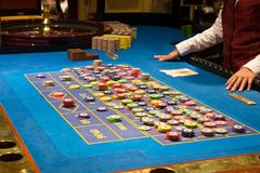 Casino. Croupier preparing and counting money on roulette casino Royalty Free Stock Photo