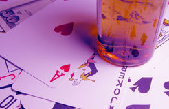 Casino. Alcohol,cards,some money and a specific light to create a casino ambient in this image Royalty Free Stock Photography