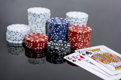 Casino abstract photo. Poker game on red background.  Theme of gambling.  royalty free stock image