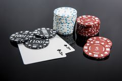 Casino abstract photo. Poker game on red background.  Theme of gambling stock image