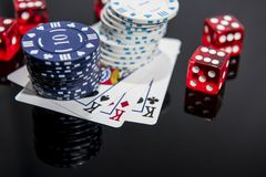 Casino abstract photo. Poker game on red background.  Theme of gambling royalty free stock photo