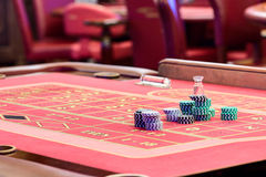 Casino American Roulette gambling table with a playing chips on the layout Stock Photo