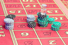 Casino American Roulette gambling table with a playing chips on the layout Royalty Free Stock Images
