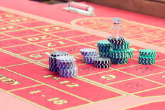 Casino American Roulette gambling table with a playing chips Stock Image