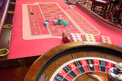 Casino American Roulette gambling table with a wheel and playing chips on the layout Royalty Free Stock Image