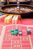 Casino American Roulette gambling table with a wheel and playing chips on the layout Stock Photo