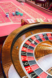 Casino American Roulette gambling table with a wheel. And playing chips on the layout stock images