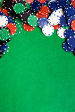 Casino Background. Casino chips on a green felt - background image Stock Photos