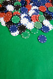 Casino Background. Casino chips on a green felt - background image stock images