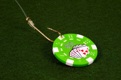Casino Bait. Poker CHip on a Fish Hook Royalty Free Stock Photos