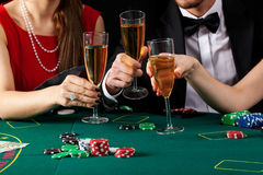 Casino champagne toast Stock Photography