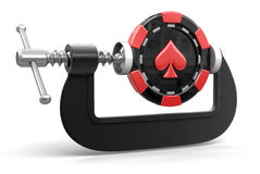 Casino chip in clamp (clipping path included) Stock Photography