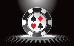 Casino chip under spotlight Royalty Free Stock Photo