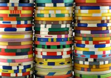 Casino chips. Three colorful casino chips stacks stock photography