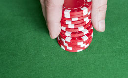 Casino chips. Hand grabbing some casino chips Royalty Free Stock Photography