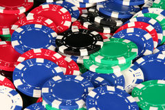 Casino Chips. Red, blue, green, black, and white poker chips in a pile Royalty Free Stock Photography