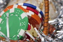 Casino chips bonus in a Christmas basket Stock Photo