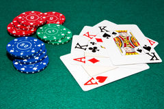 Casino chips and cards. Some casino chips and a full poker hand Royalty Free Stock Image