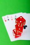 Casino chips and cards against background Royalty Free Stock Photos