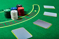 Casino chips and cards on casino table, poker game concept Royalty Free Stock Image