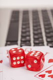 Casino chips, cards and dices stacking on laptop Royalty Free Stock Photo