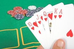 Casino chips and cards showing a royal flush Royalty Free Stock Images