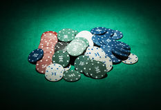 Casino chips close-up on green cloth Stock Photos