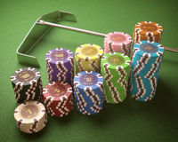 Casino Chips. Colorful chips on a green table. Concept of casino and gambling. Clipping path on the chips Stock Images