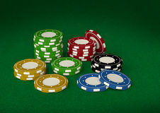 Casino chips 3D on green velvet Royalty Free Stock Photos