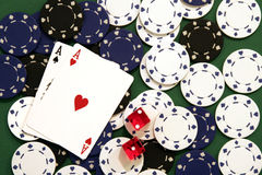 Casino Chips, Dice and Cards. On Green Background Royalty Free Stock Image