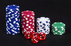 Casino chips and dices Royalty Free Stock Photos