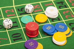 Casino chips and dices stacking Stock Image